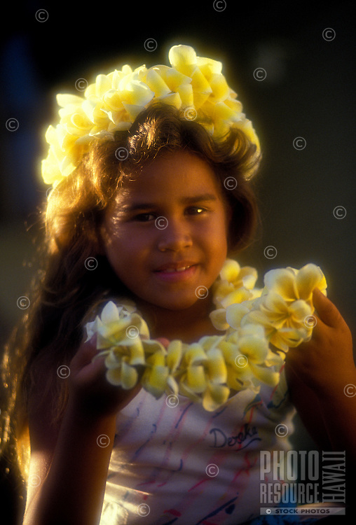 Young polynesian girl with plumeria flower lei & haku