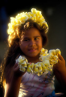 Young polynesian girl with plumeria flower lei & haku