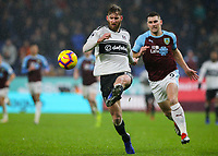 Fulham's Tim Ream plays the ball under pressure from Burnley's Sam Vokes<br /> <br /> Photographer Alex Dodd/CameraSport<br /> <br /> The Premier League - Burnley v Fulham - Saturday 12th January 2019 - Turf Moor - Burnley<br /> <br /> World Copyright © 2019 CameraSport. All rights reserved. 43 Linden Ave. Countesthorpe. Leicester. England. LE8 5PG - Tel: +44 (0) 116 277 4147 - admin@camerasport.com - www.camerasport.com