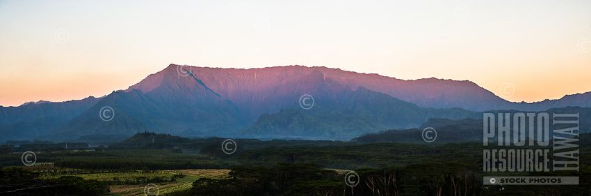 The sunrise glow over a rare cloudless Mt. Wai'ale'ale, the heart of Kaua'i and one of the wettest places on Earth.
