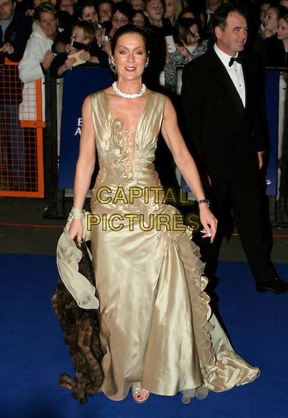 LORRAINE CHASE.National Television Awards 2005 at the Royal Albert Hall, SW7, London, UK..October 25th, 2005.Ref: AH.full length plunging neckline sleeveless ruffles green.www.capitalpictures.com.sales@capitalpictures.com.© Capital Pictures.