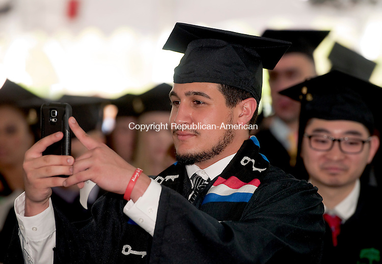 WATERBURY, CT--050915JS07-  Umberto Posca of Ansonia, takes photos of fellow graduates during the Post University's 2015 Commencement Saturday at Post University in Waterbury. Posca received his Bachelor of Science degree in Sports Management. <br /> Jim Shannon Republican-American