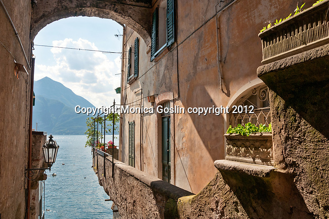 Looking out at Lake Como from a steep path between houses in Varenna, Italy