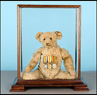 BNPS.co.uk (01202 558833)<br /> Pic: SAS/BNPS<br /> <br /> Captain Sidney 'Bert' Moy's Steiff bear 'Squadron Leader Ted'.<br /> <br /> A German teddy bear a British pilot adopted as his mascot and strapped to the front of his biplane in the First World War has survived to emerge for sale 100 years later.<br /> <br /> Captain Sidney 'Bert' Moy nicknamed his Steiff bear 'Squadron Leader Ted' and for good luck fixed his fluffy comrade to Maurice Farman MF.7 Longhorn biplanes he flew.<br /> <br /> The bears balding scalp and battered ears that are evident today are said to have been caused by its hair-raising 60mph sorties over the Western Front.<br /> <br /> It is now being sold for &pound;3,000 at auction in Newbury by a descendant of Capt Moy.