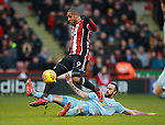 Marc Wilson of Sunderland  tackles Leon Clarke of Sheffield Utd during the Championship match at Bramall Lane Stadium, Sheffield. Picture date 26th December 2017. Picture credit should read: Simon Bellis/Sportimage