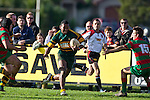 David Raikuna steps inside the reaching Steven Kennedy. Counties Manukau Premier Club Rugby game between Pukekohe and Waiuku played at Colin Lawrie Fields, Pukekohe, on Saturday July 3rd 2010. Pukekohe won 31 - 12 after leading 15 - 9 at halftime.