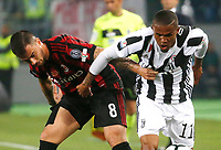 Douglas Costa of Juventus  and Suso  during the  Coppa Italia ( Tim Cup) final soccer match,  Ac Milan  - Juventus Fc       at  the Stadio Olimpico in Rome  Italy , 09 May 2018