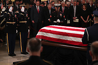 The casket of former U.S. President George H.W. Bush is delivered by a military honor guard to lie in state in the U.S. Capitol Rotunda as members of the U.S. House leadership look on during services on Capitol Hill in Washington, U.S., December 3, 2018. <br /> CAP/MPI/RS<br /> &copy;RS/MPI/Capital Pictures
