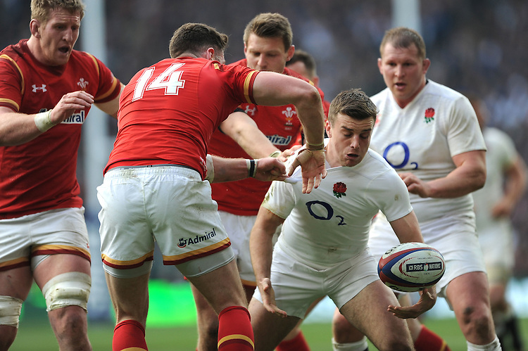 George Ford of England picks up a lose ball as Alex Cuthbert of Wales attempts to stop him during the RBS 6 Nations match between England and Wales at Twickenham Stadium on Saturday 12th March 2016 (Photo: Rob Munro/Stewart Communications)