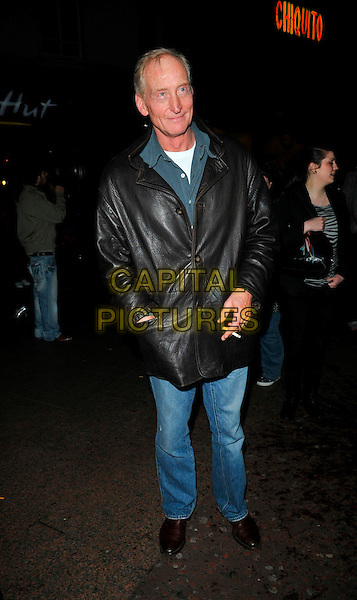 "CHARLES DANCE .UK premiere of ""Shine A Light"" Odeon Cinema, Leicester Square, London, England..April 2nd, 2008.full length jeans denim black brown leather jacket hand in pocket jeans denim cigarette.CAP/CAN.©Can Nguyen/Capital Pictures."