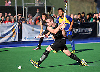 NZ captain Phil Burrows takes a shot at goal during the international hockey match between the New Zealand Black Sticks and Malaysia at Fitzherbert Park, Palmerston North, New Zealand on Sunday, 9 August 2009. Photo: Dave Lintott / lintottphoto.co.nz