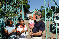 "MADAGASCAR Antananarivo, catholic priest Per Pedro Opeka has build Akamasoa a social community project with housing schemes, health units and schools for the poorest of Tana / MADAGASKAR Pater Pedro Opeka hat die Gemeinde Akamasoa , auf madagassisch ""gute Freunde"" , mit Muellsammlern, Bettlern und Sozialschwachen auf einem Huegel bei Antananarivo erbaut, Teil des Projektes sind Hausbau, Schulen, Krankenhaeuser und Beschaeftigung"