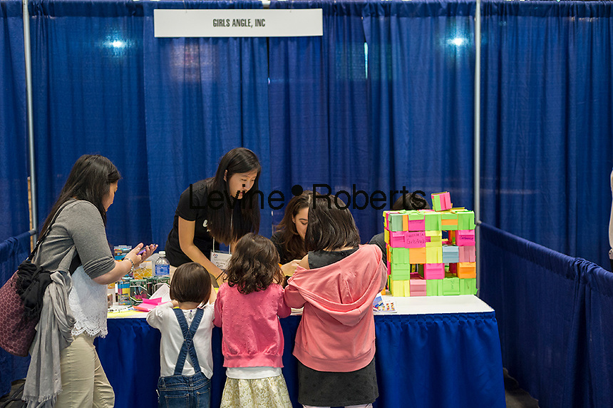 Participants visit the Girls' Angle, a math club, booth at a Career Expo held at the FIRST Robotics NYC Championship at the Jacob Javits Convention Center in New York on Sunday, March 13, 2016. The expo enables participants to speak with companies and professional organizations giving a real-world look into science and technology as used in the business world and their career opportunities. (© Richard B. Levine)