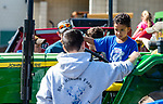 WOODBURY,  CT-052119JS03- Dean Lambert, a kindergartner at Mitchell School, talks with Nonnewuag High School senior Charlie Lewis while sitting on a tractor as students toured the Nonnewaug High School AG Department on Tuesday. <br /> Jim Shannon Republican American