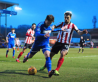 Notts County's Matt Tootle under pressure from Lincoln City's Jordan Williams<br /> <br /> Photographer Chris Vaughan/CameraSport<br /> <br /> The EFL Sky Bet League Two - Lincoln City v Notts County - Saturday 13th January 2018 - Sincil Bank - Lincoln<br /> <br /> World Copyright &copy; 2018 CameraSport. All rights reserved. 43 Linden Ave. Countesthorpe. Leicester. England. LE8 5PG - Tel: +44 (0) 116 277 4147 - admin@camerasport.com - www.camerasport.com