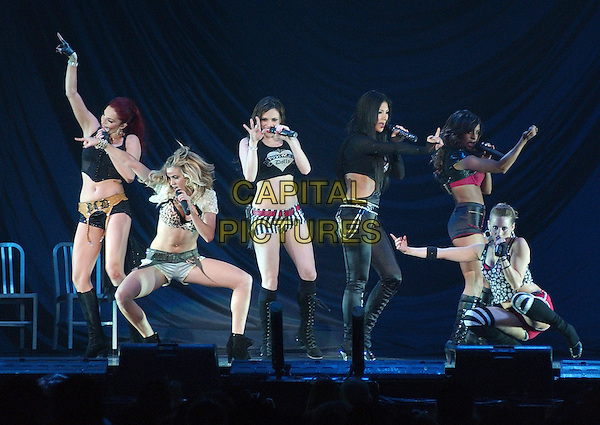 PUSSYCAT DOLLS - CARMIT BACHAR, ASHLEY ROBERTS, NICOLE SCHERZINGER, JESSICA SUTTA, MELODY THORTON & KIMBERLY WYATT.Pop R&B girl group the PUSSYCAT DOLLS perform as opening act for Christina Aguilera's 2007 Tour held at the Mellon Arena, Pittsburgh, Pennsylvania, USA..April 15th, 2007.full length stage live concert music gig performance black dancing boots skirt singing belly stomach midriff .CAP/ADM/DS.©Devin Simmons/AdMedia/Capital Pictures