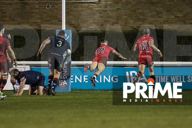 Mark Best of Jersey Reds scores a try during the Greene King IPA Championship match between London Scottish Football Club and Jersey Reds at Richmond Athletic Ground, Richmond, United Kingdom on 16 March 2018. Photo by David Horn.