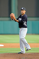 Starting pitcher Masahiro Tanaka (19) of the New York Yankees delivers a warm up pitch before a Spring Training game against the Atlanta Braves on Wednesday, March 18, 2015, at Champion Stadium at the ESPN Wide World of Sports Complex in Lake Buena Vista, Florida. The Yankees won, 12-5. (Tom Priddy/Four Seam Images)