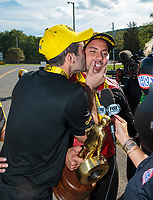 Sep 16, 2018; Mohnton, PA, USA; NHRA pro stock driver Vincent Nobile (left) kisses brother in law, pro stock motorcycle rider Hector Arana Jr as they celebrate after winning the Dodge Nationals at Maple Grove Raceway. Mandatory Credit: Mark J. Rebilas-USA TODAY Sports