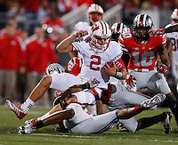 Wisconsin Badgers quarterback Joel Stave (2) is tackled by Ohio State Buckeyes linebacker Joshua Perry (37) during Saturday's NCAA Division I football game at Ohio Stadium in Columbus on September 28, 2013. (Barbara J. Perenic/Columbus Dispatch)