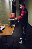 Igor Ostapchuk (Russia - Equipment Manager) sharpens a skate.