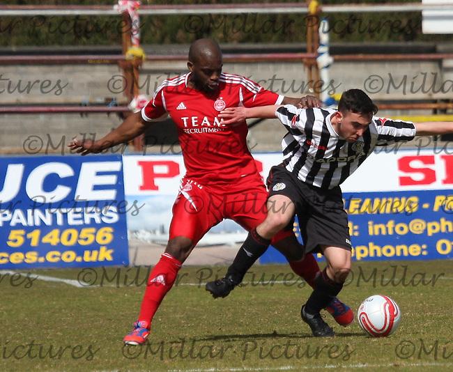 Isaac Osbourne pressures Anton Brady in the Aberdeen v St Mirren Clydesdale Bank Scottish Premier League Under 20 match played at Balmoor Stadium, Peterhead on 19.4.13.