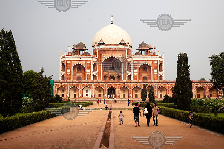 A family approach Humayun's Tomb which was commissioned in 1562.