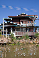 Myanmar, Burma.  Village House on Stilts,  with Satellite Dish, Inle Lake, Shan State.