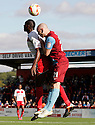 Lucas Akins of Stevenage and Tom Newey of Scunthorpe contest a header.  Stevenage v Scunthorpe United - npower League 1 -  Lamex Stadium, Stevenage - 6th October, 2012. © Kevin Coleman 2012
