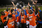 30 October 2010: Islanders players celebrate with the championship trophy. The Puerto Rico Islanders won the 2010 USSF-D2 championship 3-1 on aggregate goals after playing the Carolina RailHawks to a 1-1 tie in the second leg of the Finals in a game played at WakeMed Stadium in Cary, North Carolina.