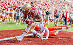 Florida State wide receiver Travis Rudolph scores on a 19 yard reception in the second half of an NCAA college football game against Syracuse in Tallahassee, Fla., Saturday, Oct. 31.  Florida State defeated Syracuse 45-21. (AP Photo/Mark Wallheiser)