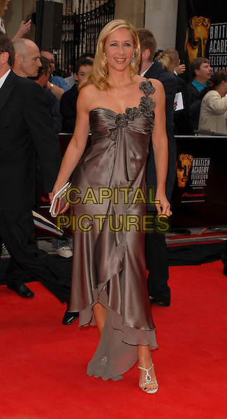 TANIA BRYER.Arrivals at the British Academy Television Awards, (BAFTA's) held at Grosvenor House Hotel, London, UK..May 7th 2006.Ref: CAN.bafta baftas full length satin brown one shoulder dress.www.capitalpictures.com.sales@capitalpictures.com.©Capital Pictures