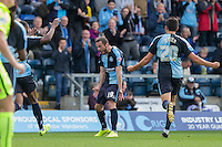 Michael Harriman of Wycombe Wanderers celebrates scoring his second goal during the Sky Bet League 2 match between Wycombe Wanderers and Hartlepool United at Adams Park, High Wycombe, England on 5 September 2015. Photo by Andy Rowland.