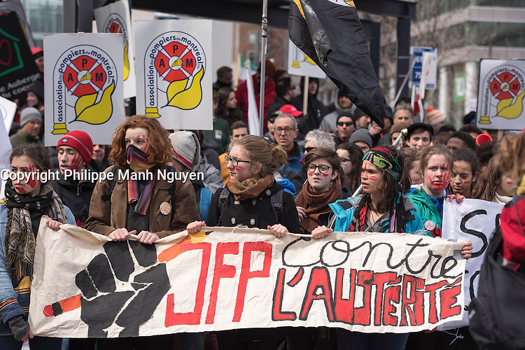 Montreal,CANADA, April 2, 1015.<br /> <br /> Students from Joseph-Francois-Perrault High school join<br /> Thousands of people including unions and students protestimg  the Quebec government's austerity measures in Montreal Thursday april 2nd.<br /> <br /> <br /> PHOTO : Philippe Manh Nguyen - Quebec Presse