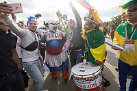 MOSCOW, RUSSIA - June 14, 2018: Russia and Brazil fans cheer and drum outside the opening match of the FIFA 2018 World Cup at Luzhniki Stadium.