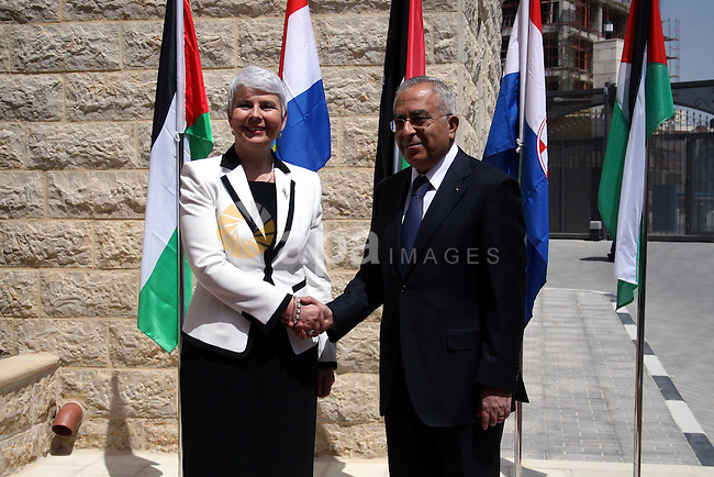 Palestinian Prime Minister Salam Fayyad and  his Croatian counterpart Jadranka Kosor attend a joint press conference after their meeting in the West Bank city of Ramallah, on March 31, 2011. Photo by Issam Rimawi
