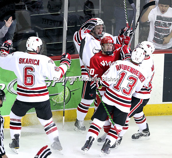 Wisconsin's Patrick Johnson gets caught in the celebration of UNO's goal during the first period. Brock Montpetit's goal put UNO up 1-0. No. 16 UNO beat No. 7 Wisconsin 4-3 Saturday night at Qwest Center Omaha. (Photo by Michelle Bishop)