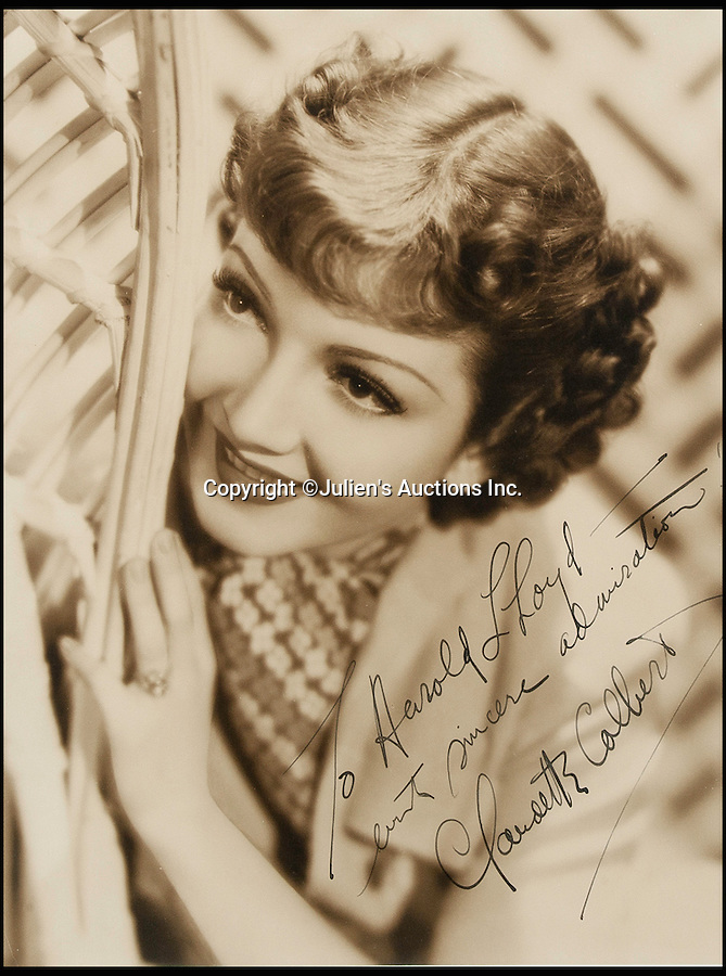 """BNPS.co.uk (01202 558833)<br /> Pic: JuliensAuctions/BNPS<br /> <br /> American actress Claudette Colbert who has been called """"The epitome of chic sophistication"""".<br /> <br /> The Rogues Gallery - Unique Who's who from the halcyon days of Hollywood, collected by one of their own, comedian Harold Lloyd.<br /> <br /> The silent movie actor asked his silver screen chums to send him their best loved publicity shots one Xmas, so he could create a 'Rogues Gallery' at his Hollywood mansion.<br /> <br /> The unique collection reveals tinsel town as it preferred to see itself in its most glamourous era between the wars."""
