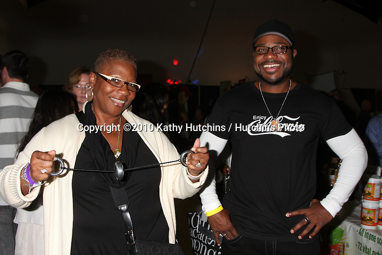 LOS ANGELES - NOV 20:  Malcolm-Jamal Warner,Mom at the Connected's Celebrity Gift Suite celebrating the 2010 American Music Awards at Ben Kitay Studios on November 20, 2010 in Los Angeles, CA