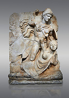 Roman Sebasteion relief  sculpture of emperor Claudius and Britannia, Aphrodisias Museum, Aphrodisias, Turkey. <br /> <br /> Naked warrior emperor Claudius is about to deliver a death blow to the slumped Britannia. He wears a helmet, cloak and sword belt with a scabbard. Britannia wears a tunic with one breast exposed like the Amazon figures she was modelled on. The inscription reads: Tiberios Klaudios Kaiser - Bretannia.