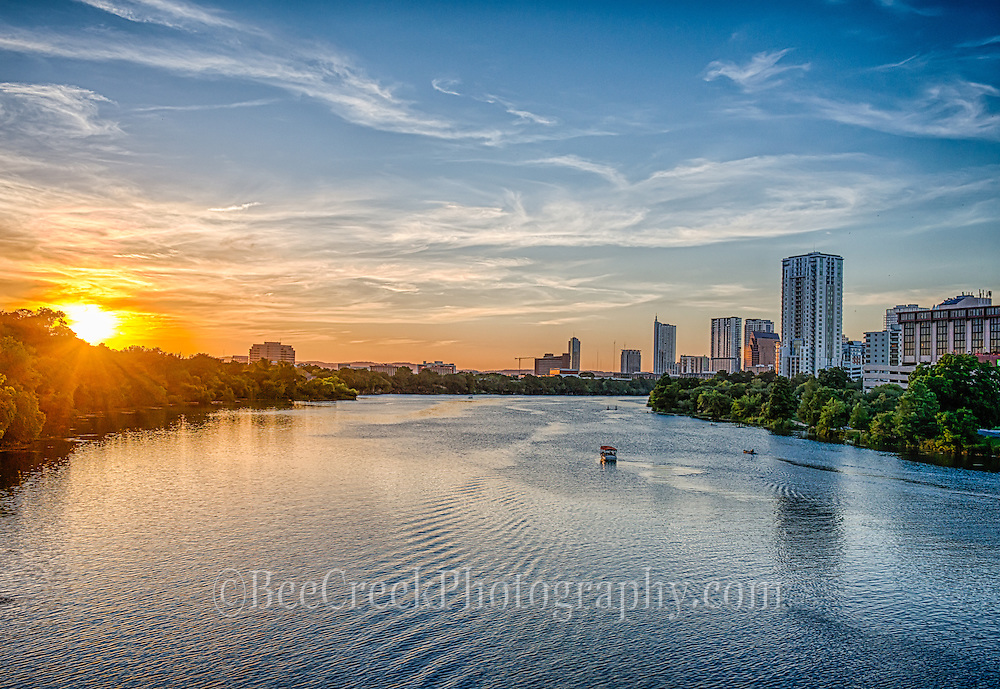I love this view of the Austin Skyline as the sun was setting.  The wispy clouds over the ladybird lake at sunset created a lovely orange glow over the city buildings and the lake.  You can see one of the riverboats on the water heading upstream to catch the best spot for the sunset over Austin.