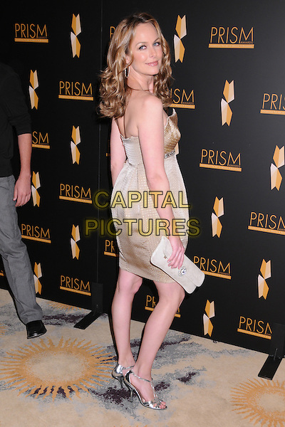 MELORA HARDIN.12th Annual PRISM Awards at the Beverly Hills Hotel, Beverly Hills, California, USA..April 24th, 2008.full length brown beige strapless dress gold silver shoes clutch bag looking over shoulder .CAP/ADM/BP.©Byron Purvis/AdMedia/Capital Pictures.