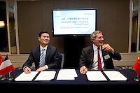 Shanghai Office of Financial Services Director-General Fang Xinghai (left) and GDF Suez CEO and Paris Europlace Chairman Gerard Mestrallet (right), get ready to sign a Memorandum of Understanding between Paris Europlace and Shanghai Financial Services, at Shanghai / Paris Europlace Financial Forum, in Shanghai, China, on December 1, 2010. Photo by Lucas Schifres/Pictobank