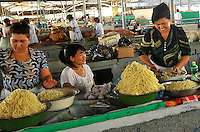 Women selling noodles at market