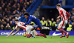 Willian of Chelsea is challenged by Geoff Cameron of Stoke City and Josh Tymon of Stoke City during the premier league match at Stamford Bridge Stadium, London. Picture date 30th December 2017. Picture credit should read: Robin Parker/Sportimage