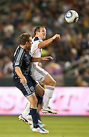 CARSON, CA – May 14, 2011: Sporting KC defender Michael Harrington (2) and LA Galaxy forward Chad Barrett (11) go up high during the match between LA Galaxy and Sporting Kansas City at the Home Depot Center in Carson, California. Final score LA Galaxy 4, Sporting Kansas City 1.