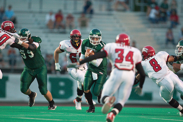 DENTON, TX  SEPTEMBER 27 :  Scott Hall #11 - North Texas Mean Green Football vs Jerrell Carter #34, Ricky Calais #8 - Louisiana Lafayette Ragin Cajuns at Fouts Field in Denton on September 27, 2003 in Denton, NT won 44-23. Photo by Rick Yeatts