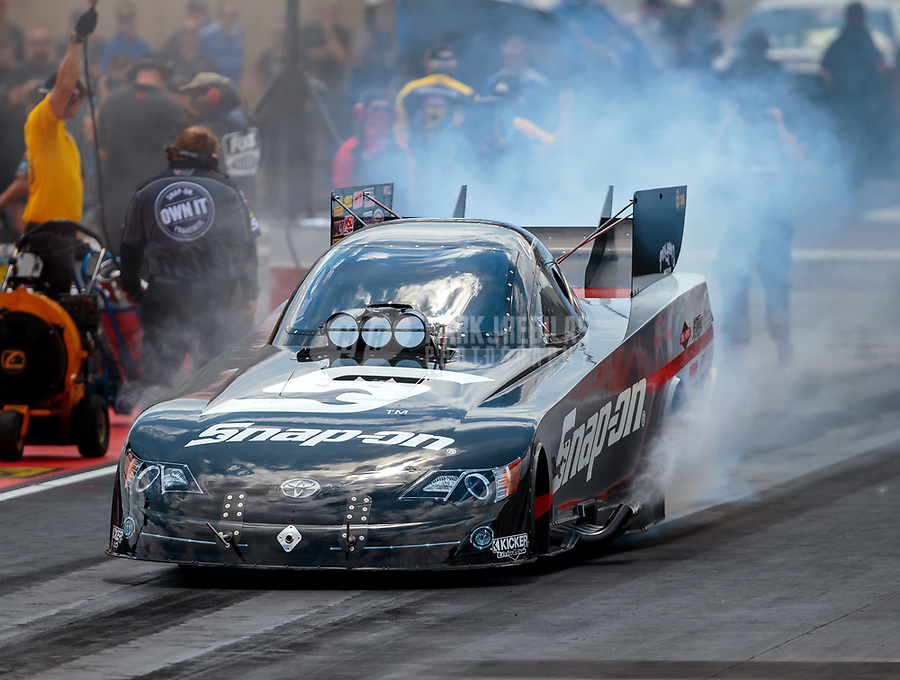 Jul 22, 2018; Morrison, CO, USA; NHRA funny car driver Cruz Pedregon during the Mile High Nationals at Bandimere Speedway. Mandatory Credit: Mark J. Rebilas-USA TODAY Sports