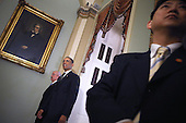 Accompanied by Sergeant at Arms of the United States Senate Terrance Gainer (L), U.S. President Barack Obama leaves after meeting with members of the Senate Democratic Caucus in the Mansfield Room at the U.S. Capitol March 12, 2013 in Washington, DC. With tax reform, spending cuts, gun control and immigration on the agenda, Obama will be holding four meetings over three days this week with Republican and Democratic members of Congress at the U.S. Capitol. .Credit: Chip Somodevilla / Pool via CNP
