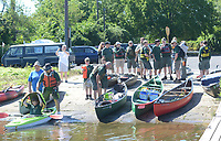 The scouts load onto their boats for the ride to Burlington island along the Delaware River Sunday, July 30, 2017 in Burlington, New Jersey. Andrew Stillman, and his scout troop rowed to Burlington Island  to install posts with steel markers for his Eagle Scout project. They installed the posts with trail numbers at various trails to mark the trails. Until now, emergency services and the city's officials worry has been that a call for help (injury, illness) could delay response because of the size of the Island and the growth. With the trail markers - the city has helped map those trails out- EMS and the marine police will have a better chance to quickly locate someone in trouble. (Photo by William Thomas Cain)